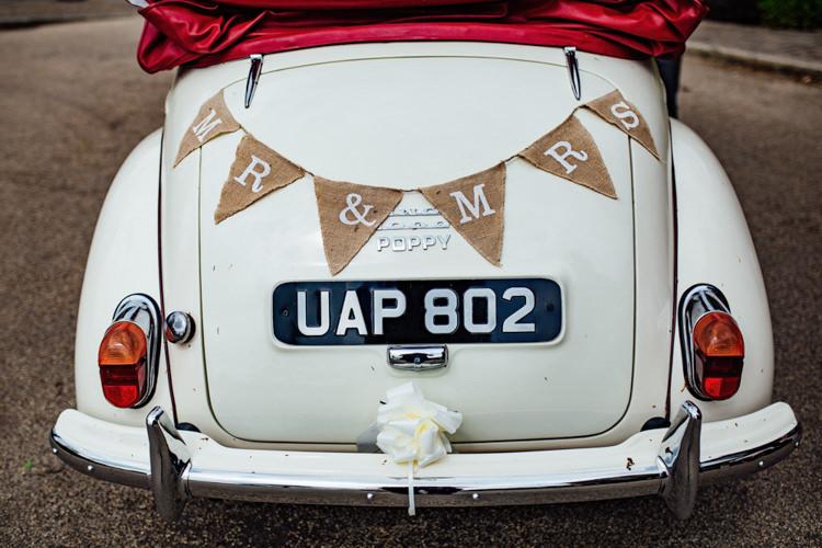 Transport Car Morris Minor Mr & Mrs Bunting Hessian Boho DIY Secret Garden Wedding https://bibandtuckerphotography.co.uk/