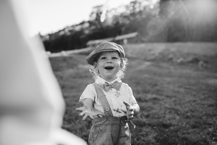 Outdoor Field Forest Wild Nature Marquee Tipi Reception Rustic Pageboy Bowtie Child | Breathtaking Secluded Back Garden Open Sided Tent Wedding Vermont https://kickasscouples.com/
