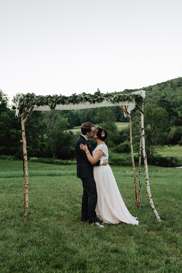 Outdoor Field Forest Wild Nature Floral Arch Bride Groom Kiss Ceremony | Breathtaking Secluded Back Garden Open Sided Tent Wedding Vermont https://kickasscouples.com/