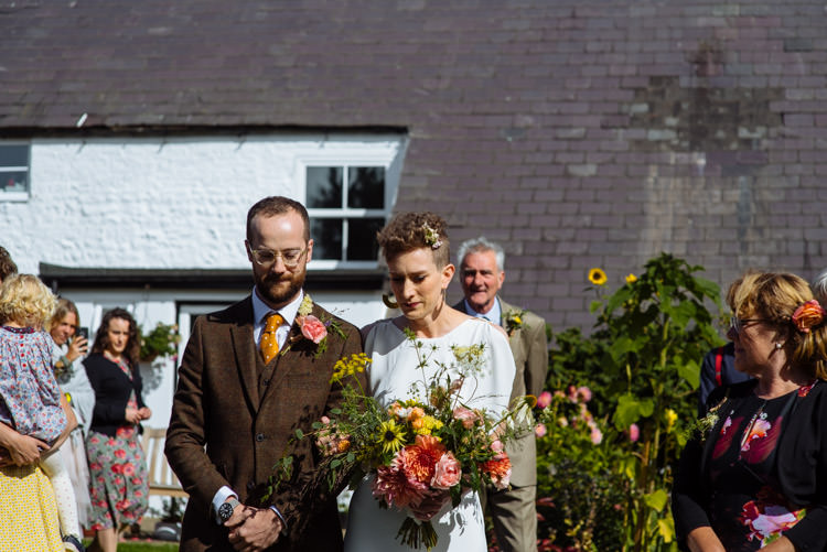 DIY Ceremony Aisle Bride Groom Yellow Wildflower Bouquet Seasonal Alternative Hippy Farm Field Garden Wedding | Homegrown Community Eclectic Rural Yorkshire Wedding https://toastofleeds.co.uk/
