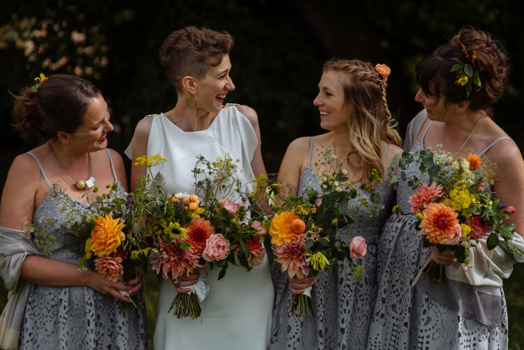 DIY Bride Bridesmaids Grey Dresses Seasonal Yellow Orange Wildflowers Alternative Hippy Garden Wedding | Homegrown Community Eclectic Rural Yorkshire Wedding https://toastofleeds.co.uk/