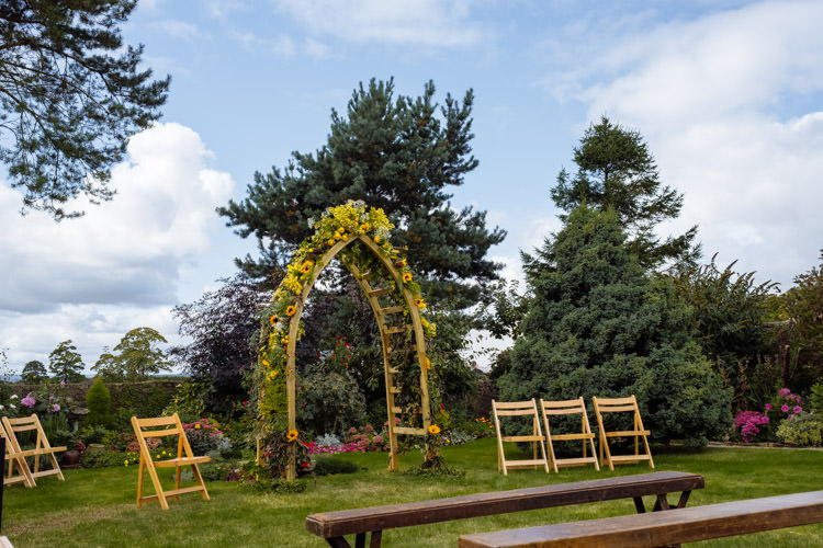 DIY Ceremony Flower Arch Yellow Orange Seasonal Alternative Hippy Farm Field Garden Wedding | Homegrown Community Eclectic Rural Yorkshire Wedding https://toastofleeds.co.uk/