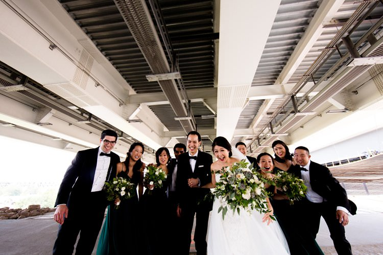 Bride Groom Bridesmaids Groomsmen Group Photo Bridge Hangar | Black Tie Carnival Wedding Hot Air Balloon http://www.makingthemoment.com/