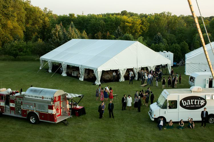 Outdoor Summer Field Rustic Marquee Tipi Tent Street Food Trucks | Black Tie Carnival Wedding Hot Air Balloon http://www.makingthemoment.com/