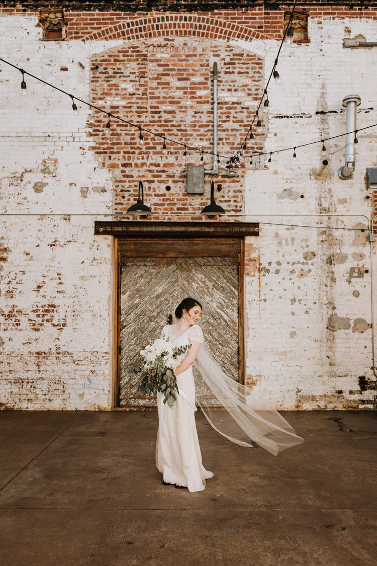 City Urban Georgia Engine Room Exposed Bricks Bride White Foliage Bouquet Veil | Bohemian Industrial Oxblood Wedding https://www.lunaleephotos.com/