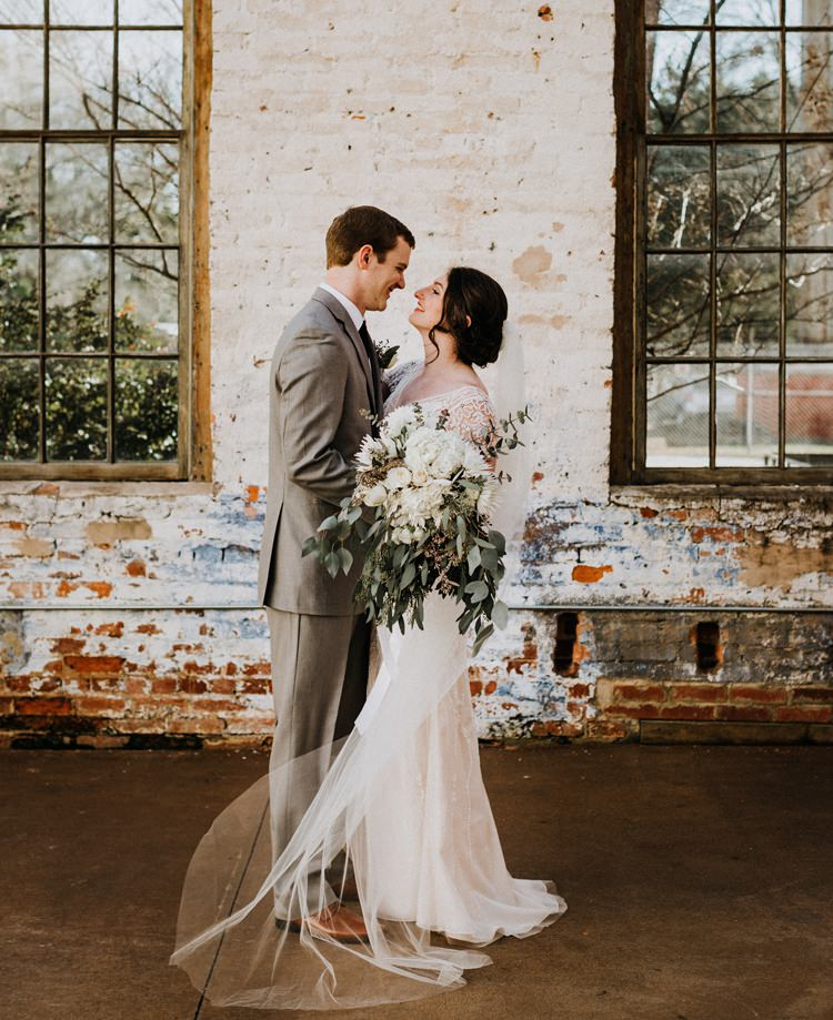 City Urban Georgia Engine Room Exposed Bricks Bride Groom White Foliage Bouquet | Bohemian Industrial Oxblood Wedding https://www.lunaleephotos.com/