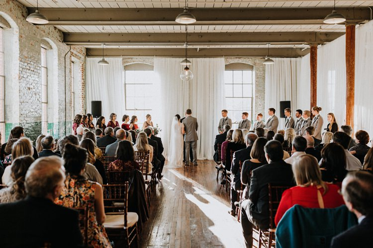 City Urban Georgia Engine Room Exposed Bricks Ceremony Aisle Bride Groom | Bohemian Industrial Oxblood Wedding https://www.lunaleephotos.com/