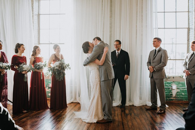 City Urban Georgia Engine Room Exposed Bricks Ceremony Aisle Bride Groom Greenery White Bouquet | Bohemian Industrial Oxblood Wedding https://www.lunaleephotos.com/