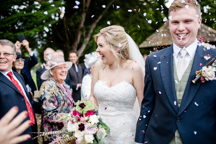 Bride Bridal Lace Strapless Dress Tulle Veil Bouquet Multicoloured Pheasant Feather Groom Blue Tails Waistcoat Three Piece Suit Confetti Autumn Countryside Family Farm Wedding Dorset http://www.lydiastampsphotography.com/