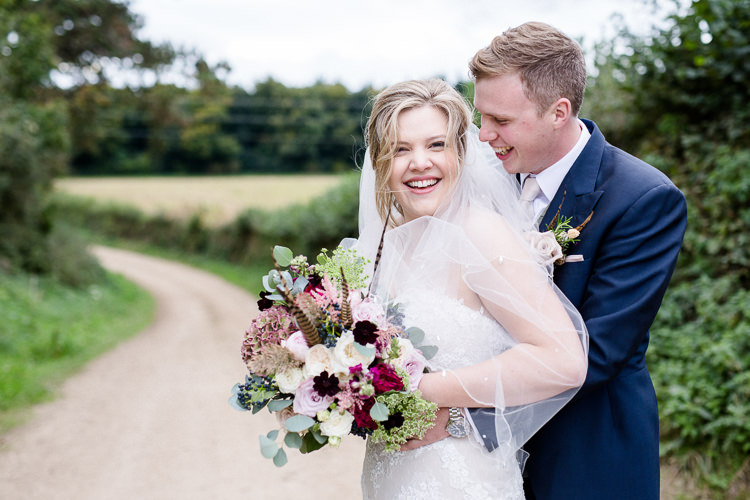 Bride Bridal Lace Strapless Dress Tulle Veil Bouquet Multicoloured Pheasant Feather Groom Blue Tails Waistcoat Three Piece Suit Autumn Countryside Family Farm Wedding Dorset http://www.lydiastampsphotography.com/