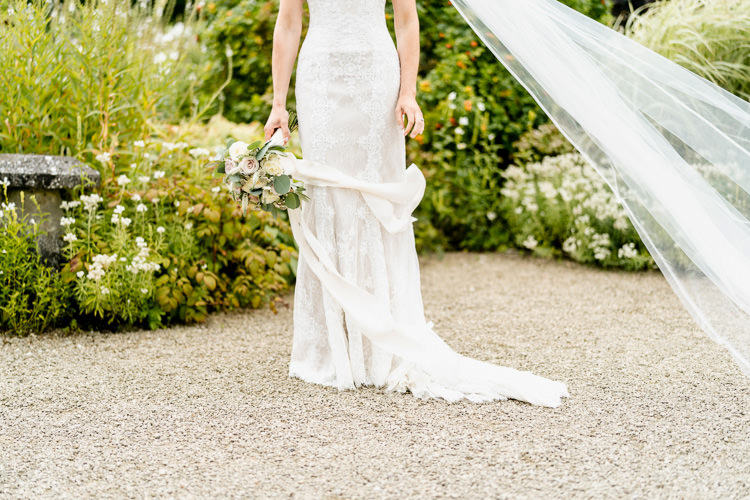 Lace Keyhole Neck Fitted Pronovias Dress Gown Bride Bridal Veil Bouquet Ribbon Nostalgic Honest British Loseley Park Wedding Surrey https://www.johnbarwoodphotography.co.uk/