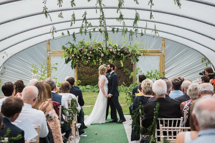 Bride Bridal Gown Dress Backless Simple Cap Sleeve Lace Train Flower Greenery Crown Blue Suit Hackett Groom Hanging Foliage Greenery Spring Floral Polytunnel Sunny Wedding Colstoun House Scotland http://solenphotography.co.uk/
