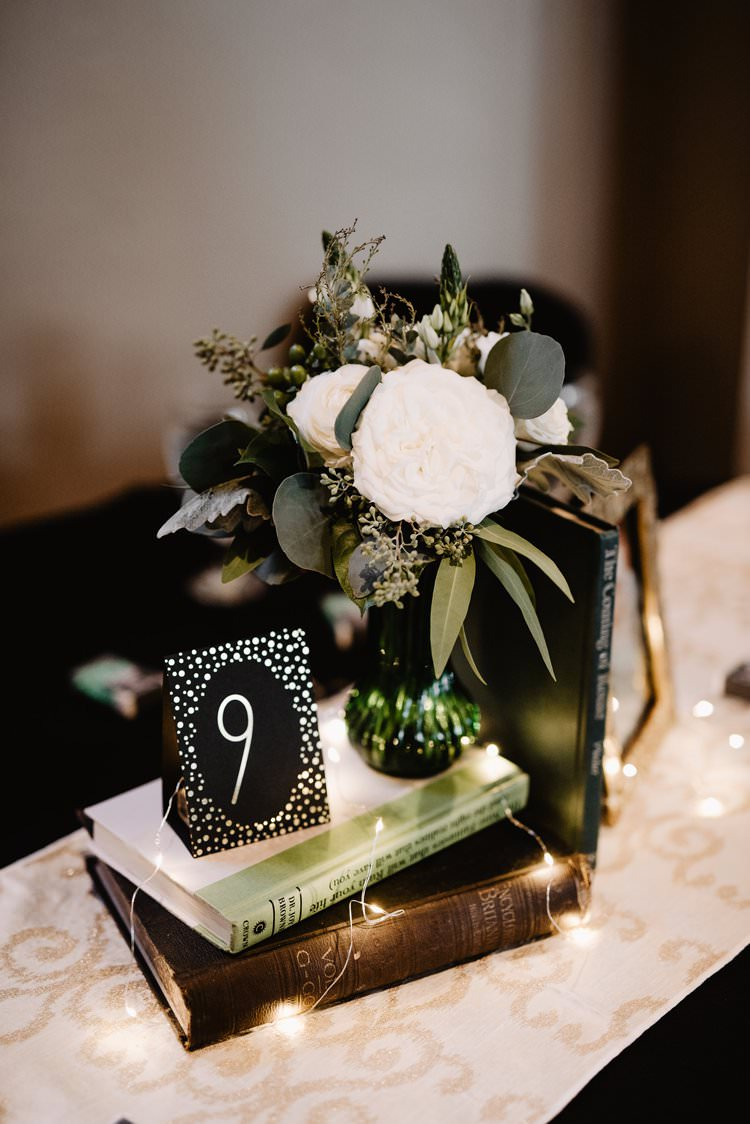 Book Fairylights Centrepiece Romantic Table Decor Number Sign Emerald Greenery White Flowers | Dreamy Blush Emerald Fairytale Wedding Oklahoma http://www.kelcyleighphotography.com/