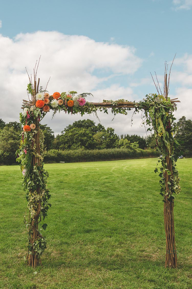 Ceremony Arch Floral Rustic Greenery Foliage Colourful Outdoor Tipi Farm Wedding https://kirstymackenziephotography.co.uk/