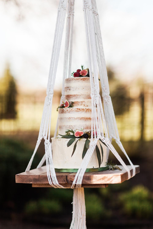 Semi Naked Cake Foliage Buttercream Hanging Suspended Swing Botanical Macrame Glass House Wedding Ideas Jo Bradbury Photography