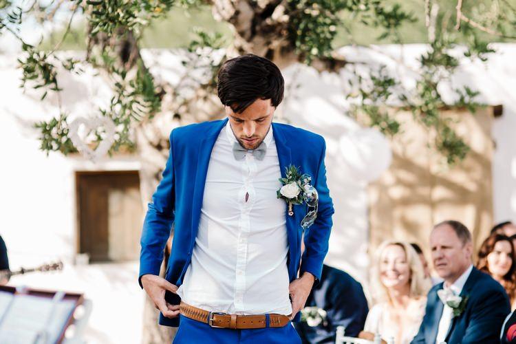 Spain Sun Outdoor Tropical Mediterranean Garden Villa Outdoor Ceremony Groom Blue Suit | Ibiza Destination Wedding Amy Faith Photography
