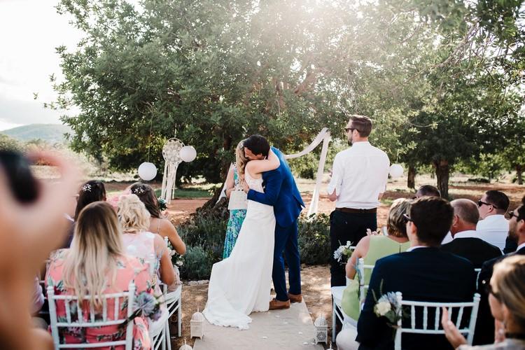 Spain Sun Outdoor Tropical Mediterranean Garden Villa Outdoor Ceremony Hugs Kiss | Ibiza Destination Wedding Amy Faith Photography