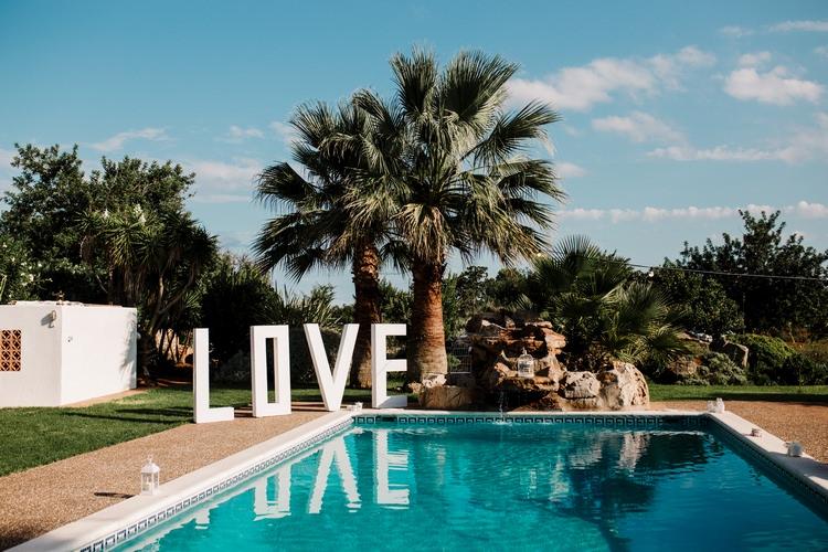Spain Sun Outdoor Tropical Mediterranean Garden Villa Outdoor Pool Party Giant Love Letters | Ibiza Destination Wedding Amy Faith Photography