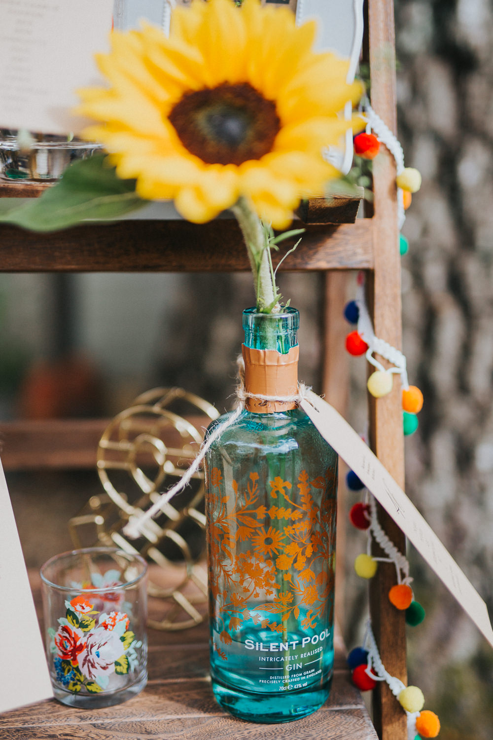 Gin Bottle Seating Plan Table Chart Flowers Wooden Ladder Colourful Bright Summer Pub Wedding Charlotte Razzell Photography