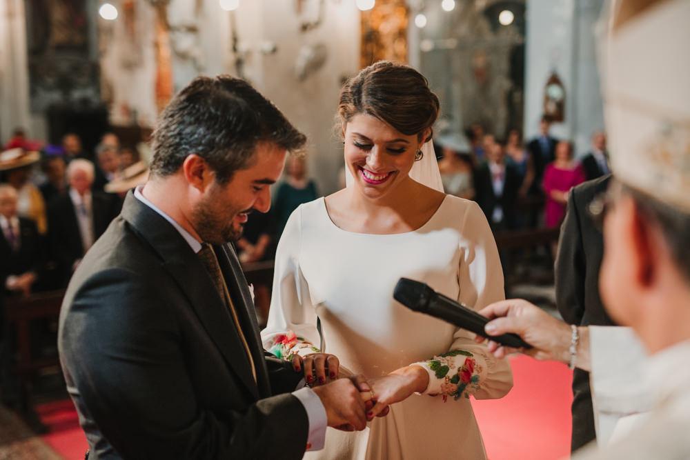 Outdoor Seville Destination Baroque Church Aisle Ceremony Bride Groom Rings | Colorful and Heartfelt Wedding in Spain Boda&Films