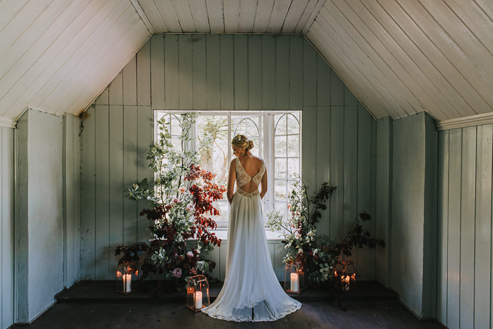 Secret Dresshouse Ethereal Bride Bridal Gown Storm Hurricane Candles Lanterns Leaf Foliage Flower Florals River Romance Wedding Ideas Mindy Coe Photography