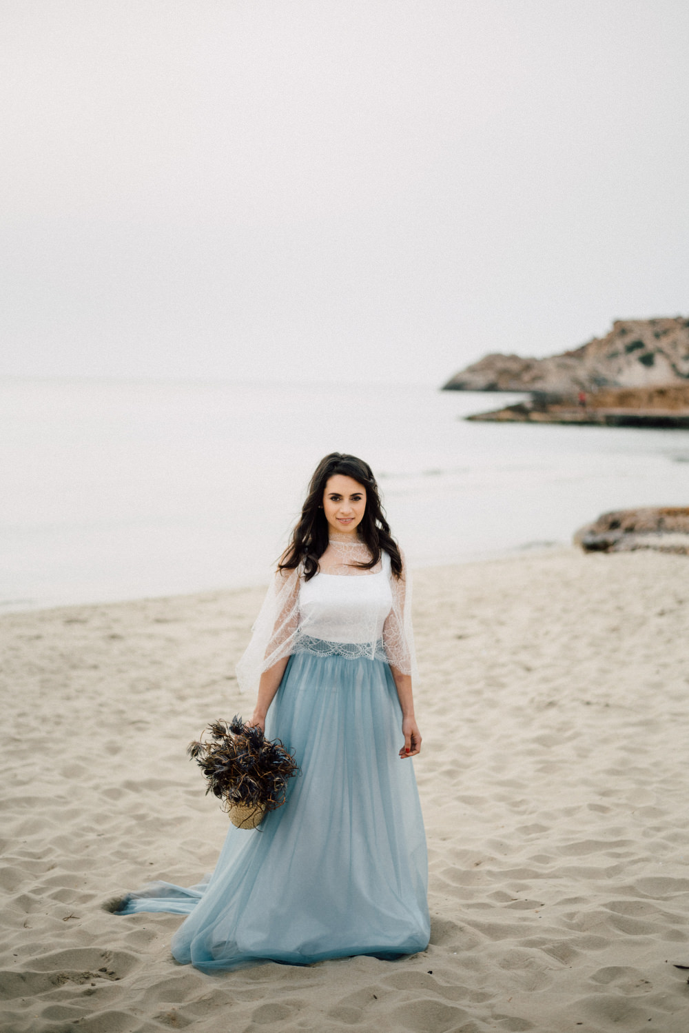 Outdoor Wild Nature Destination Spain Europe Coastal Styled Shoot Bride Blue Gown Lace   Blue Ibiza Elopement Ideas and Surprise Proposal Serena Genovese Photography