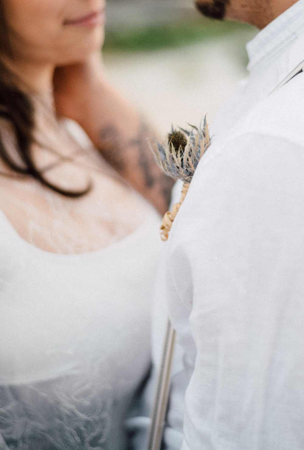 Outdoor Wild Nature Destination Spain Europe Beach Styled Shoot Groom Braces Bride Blue Gown Lace Sea Holly Buttonhole   Blue Ibiza Elopement Ideas and Surprise Proposal Serena Genovese Photography