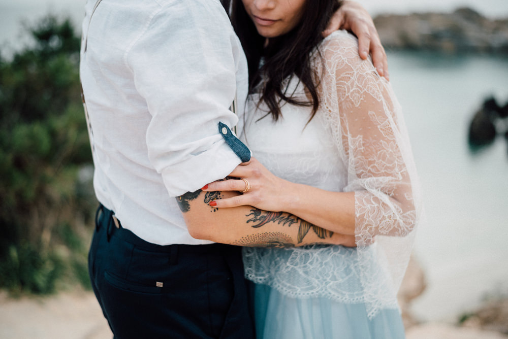Outdoor Wild Nature Destination Spain Europe Sea Beach Styled Shoot Groom Braces Bride Blue Gown Lace   Blue Ibiza Elopement Ideas and Surprise Proposal Serena Genovese Photography