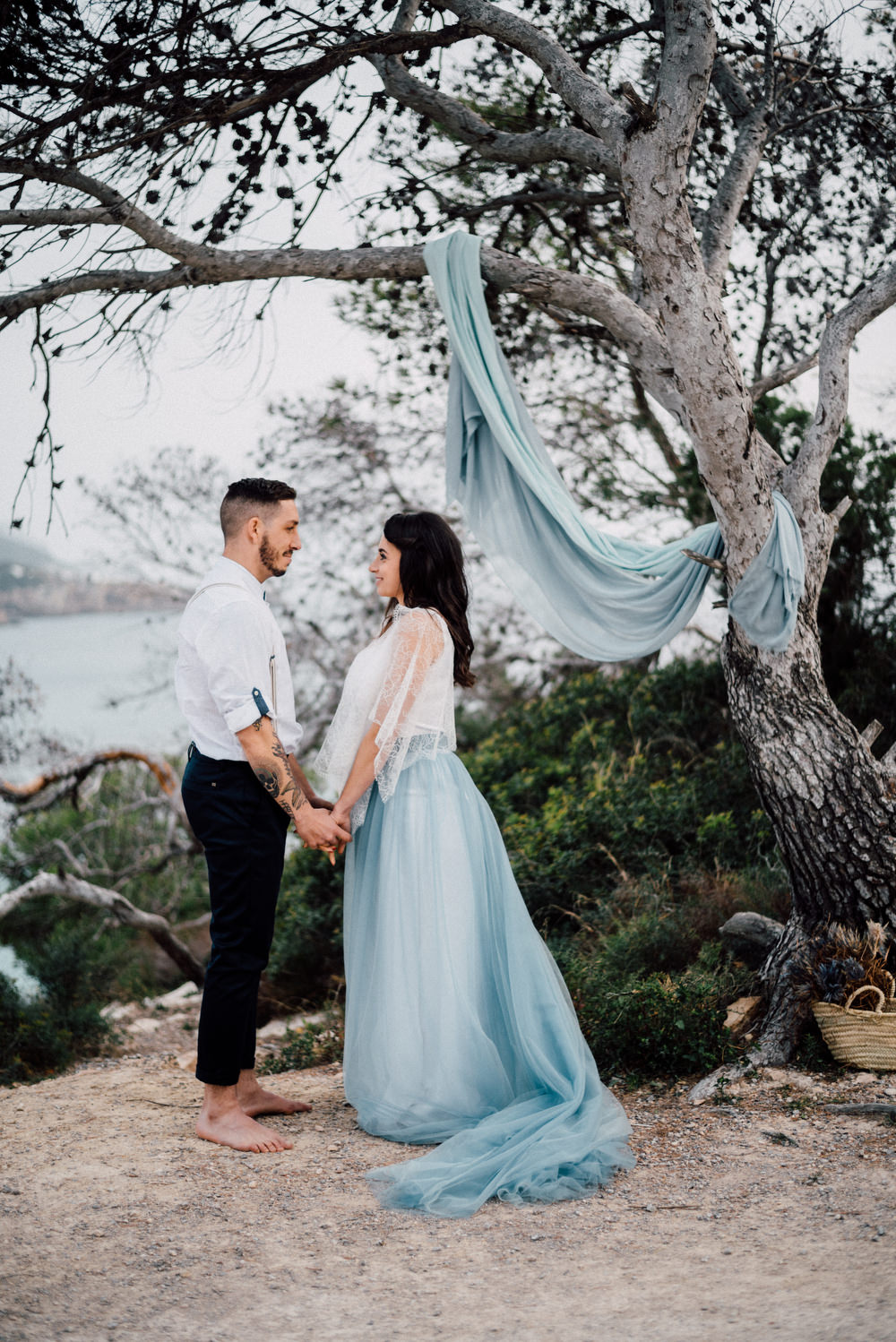 Outdoor Wild Nature Destination Spain Europe Sea Beach Styled Shoot Groom Braces Bride Blue Gown Lace Ceremony   Blue Ibiza Elopement Ideas and Surprise Proposal Serena Genovese Photography
