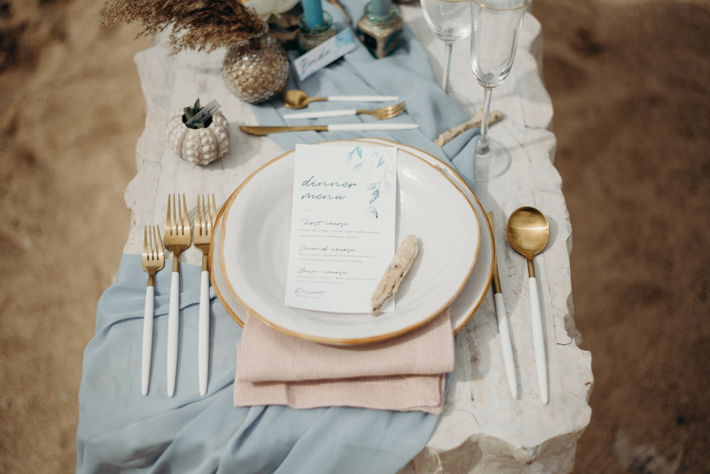 Outdoor Wild Nature Destination Spain Europe Coastal Styled Shoot Beach Table Elegant Styling Menu Driftwood   Blue Ibiza Elopement Ideas and Surprise Proposal Serena Genovese Photography