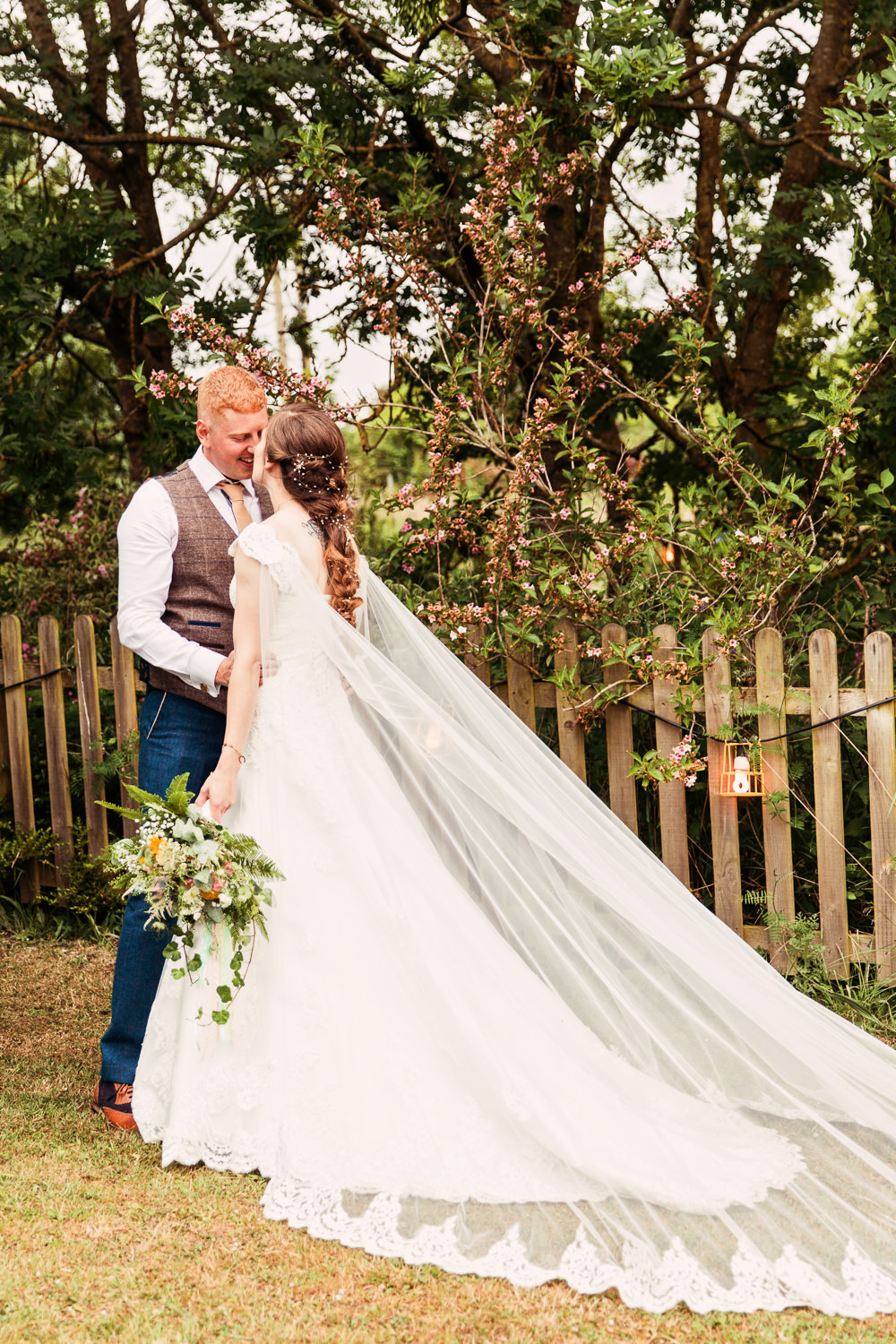 Bride Bridal Bespoke Dress Cape Sweetheart Neckline A Line Lace Tweed Mismatched Waistcoat Groom Embellished Plait Hair Meadow Wildflower Bouquet Festival Wedding Mismatched Country Camilla Lucinda Photography