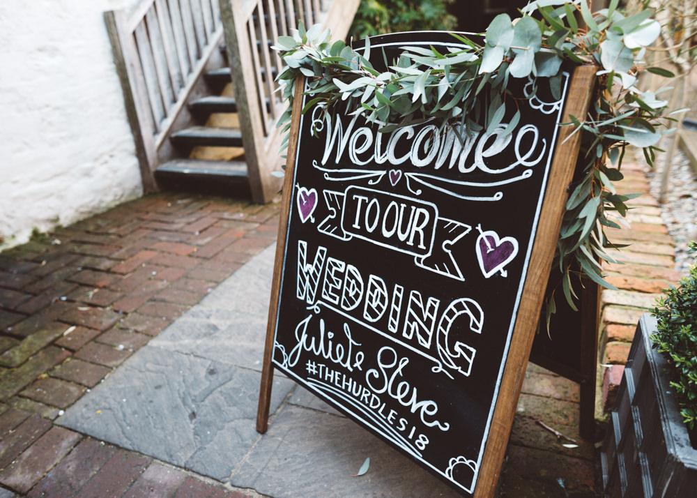 Chalk Black Board Welcome Sign Foliage Greenery George Rye Wedding Hollie Carlin Photography