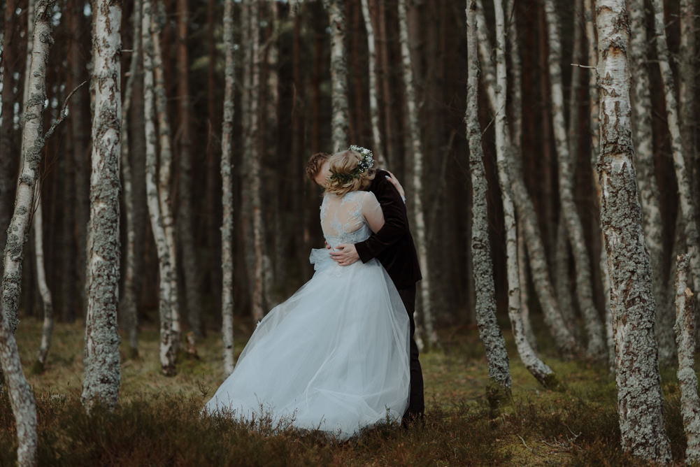 Forest Trees Castle Loch Blue Wedding Dress Flower Crown Bride Groom Portraits | Intimate Winter Outdoor Scotland Wedding Christopher Ian Photography