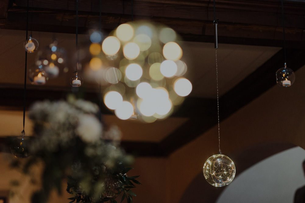 Forest Trees Castle Loch Simple Decor Greenery Fairy Lights Hanging Flowers | Intimate Winter Outdoor Scotland Wedding Christopher Ian Photography