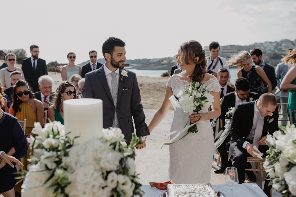 Bride Bridal Fishtail Lace Cap Sleeve Sweetheart Dress Gown Grey Suit Groom Candle Ceremony Greece Destination Wedding Elena Popa Photography