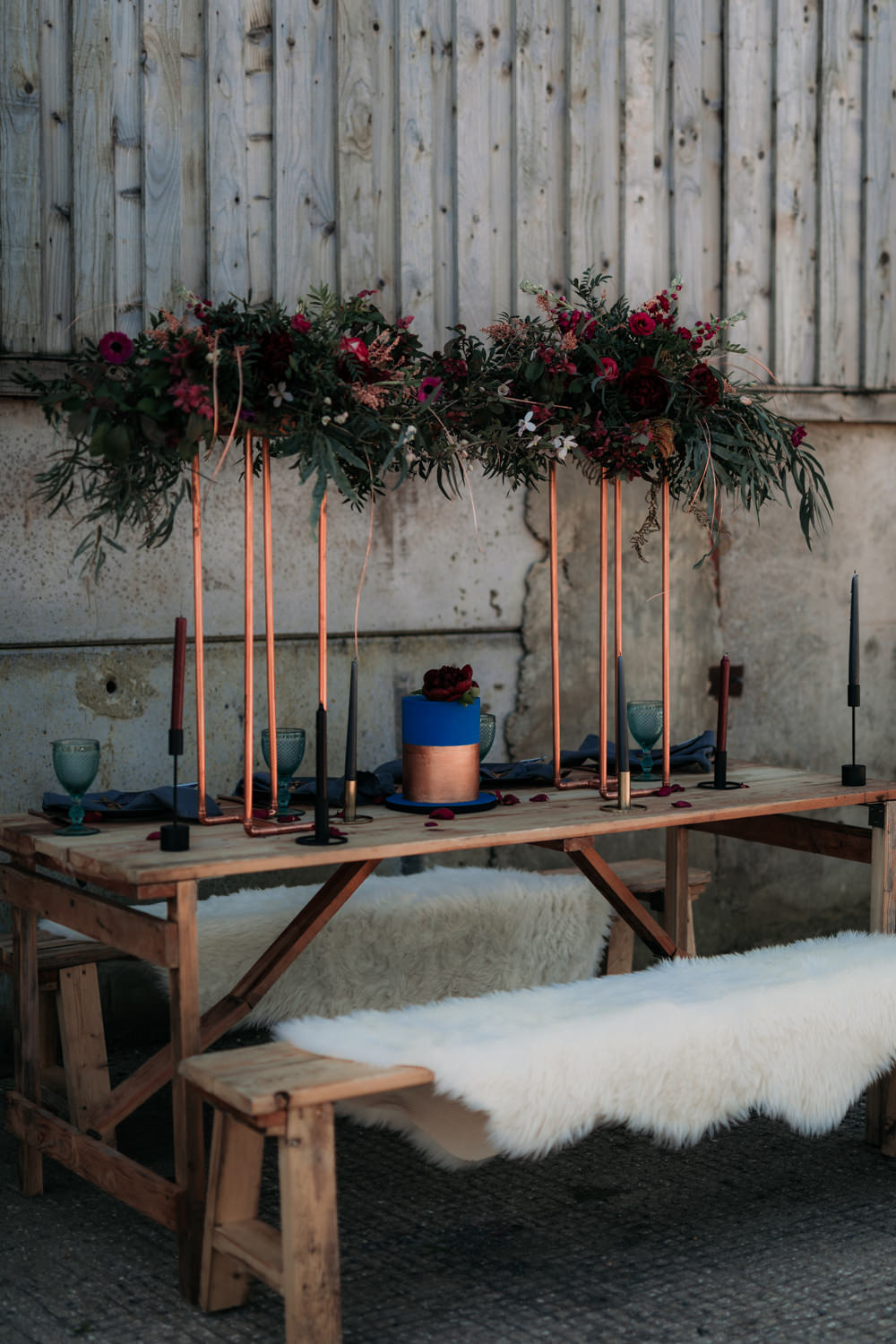 Table Set Up Tablescape Decor Suspended Flowers Copper Navy Blue Magenta Sheepskin Industrial Luxe Wedding Ideas Balloon Installation Ayelle Photography