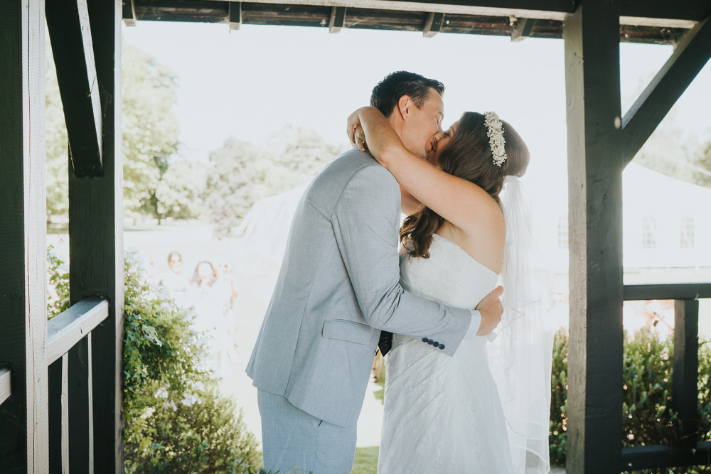 Intimate Outdoor Natural Relaxed Laid Back Summer Gazebo Ceremony Aisle Groom Bride Kiss | Prested Hall Wedding Grace Elizabeth Photography