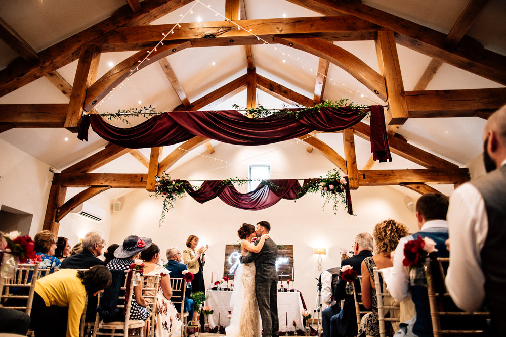 Burgundy Red Drapes Ceiling Fabric Fairy Lights Aisle Chair Flowers Ribbons Ceremony Gamekeepers Inn Wedding Fairclough Studios