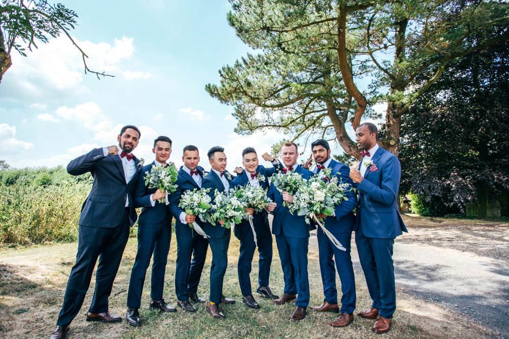 Groom Groomsmen Blue Suits Burgundy Bow Ties Bouquets Long Barn Wedding Three Flowers Photography
