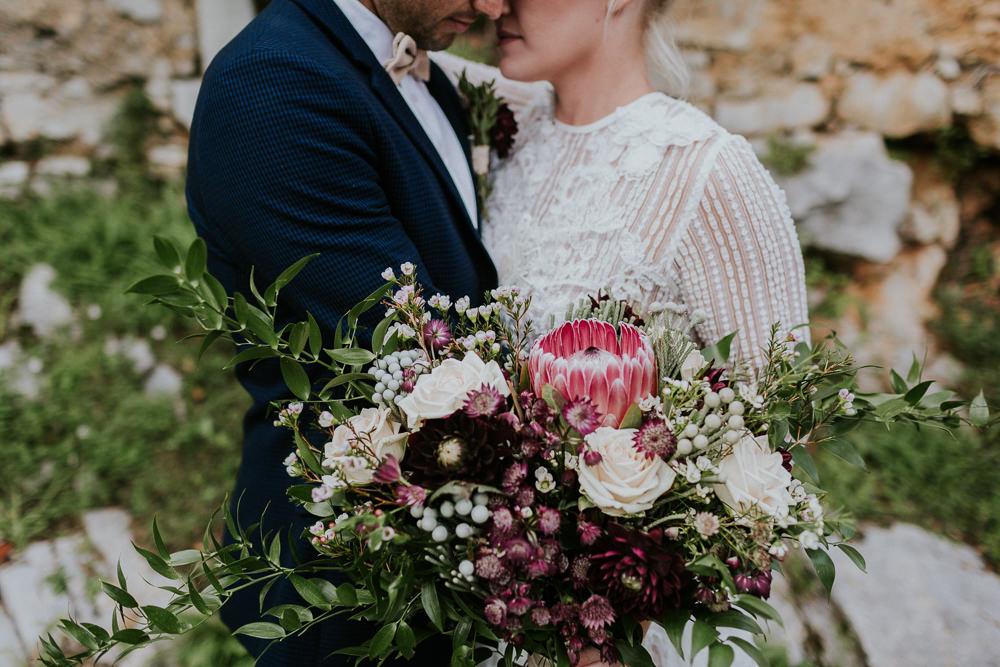 Bouquet Flowers Bride Bridal Protea Greenery Foliage Berries Rose Ribbons Slovenia Wedding Bohemian Maja Tsolo Photography