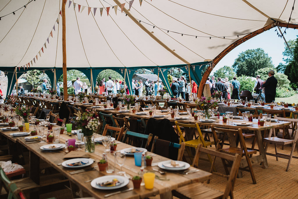 Pole Tent Marquee Rustic Furniture Table Chairs Festoon Lights Bunting Open Sides Eco Friendly Wedding The Stag and the Doe