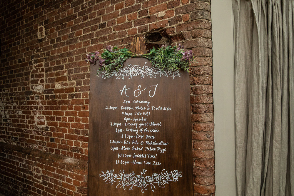 Wooden Wood Sign Easel Calligraphy Order Day Rustic Botanical Barn Wedding Lorna Newman Photography