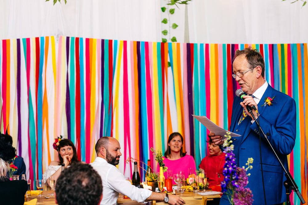 Rainbow Colourful Ribbon Backdrop Ash Barton Estate Wedding Jordanna Marston Photography