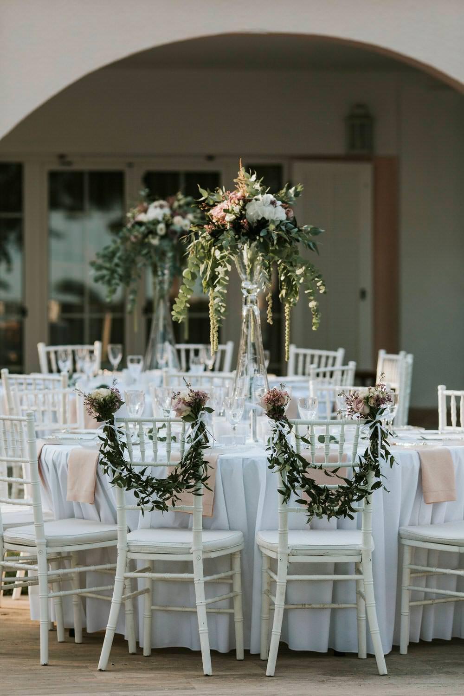 Swag Garland Greenery Foliage Chair Backs Decor Bohemian Beach Greece Destination Wedding Lighthouse Photography