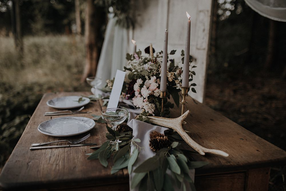 Table Flowers Tablescape Wild Natural Arrangement Candles Antler Greenery Foliage Runner Bohemian Woodland Wedding Ideas Lola Rose Photography