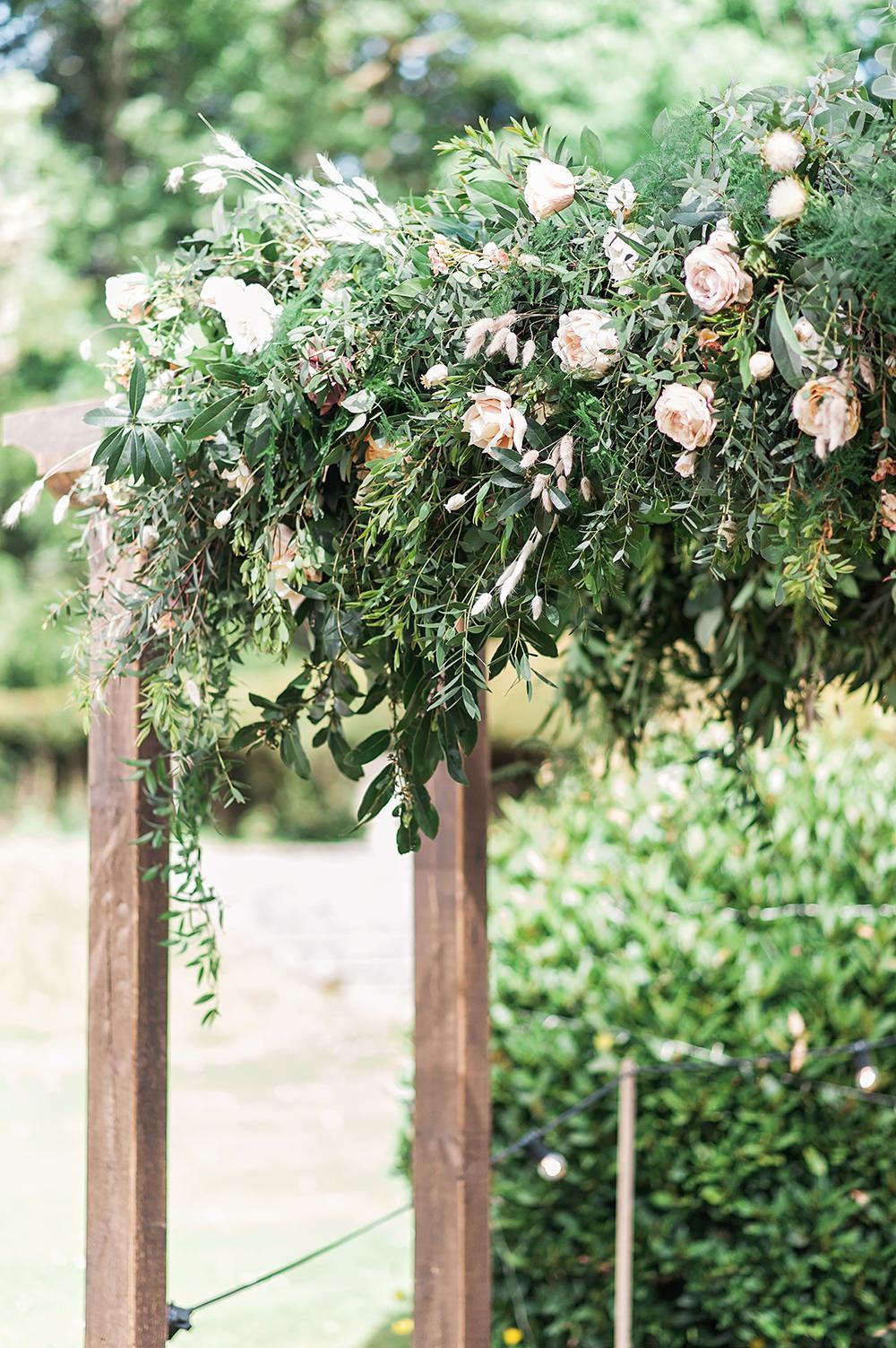 Foliage Pink Rose Archway Backdrop Edmondsham House Wedding Darima Frampton Photography