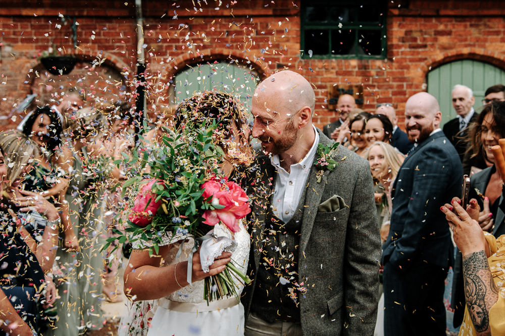 Bride Bridal Dress Gown Lace Detail Drop Cold Shoulder Ribbon Bow Sleeveless Tweed Suit Waistcoat Groom Floral Veil Bouquet Confetti Stanford Farm Wedding Andy Griffiths Photography