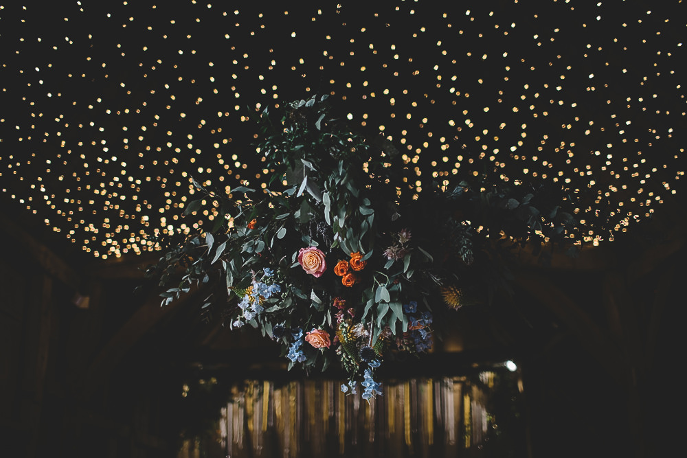 Hanging Suspended Flowers Greenery Rose Orange Coral Decor Gilbert Whites House Barn Wedding Carrie Lavers Photography
