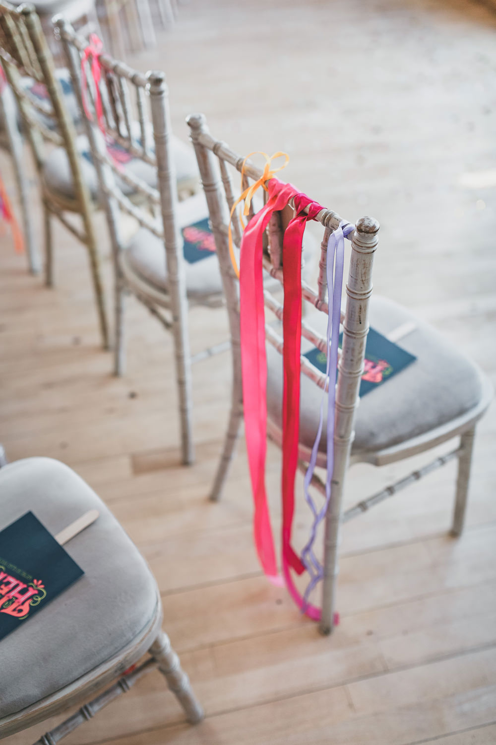 Ribbons Chairs Colourful Decor Rock Village Hall Wedding Lucie Hamilton Photography