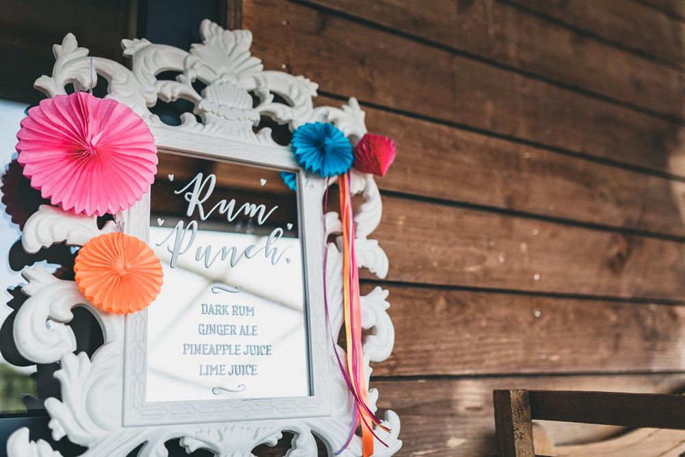 Colourful Pinwheels Mirror Calligraphy Sign Drinks Bar Rock Village Hall Wedding Lucie Hamilton Photography
